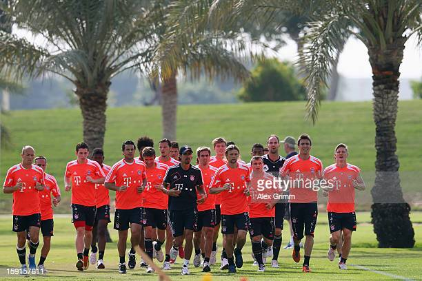 Players run during a Bayern Muenchen training session at the ASPIRE Academy for Sports Excellence on January 9 2013 in Doha Qatar