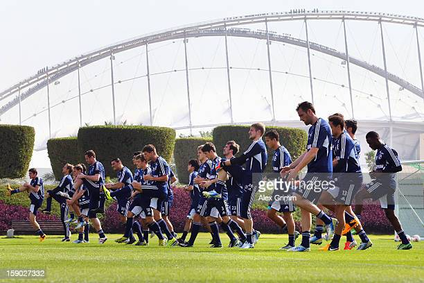 Players run during a Schalke 04 training session at the ASPIRE Academy for Sports Excellence on January 6, 2013 in Doha, Qatar.