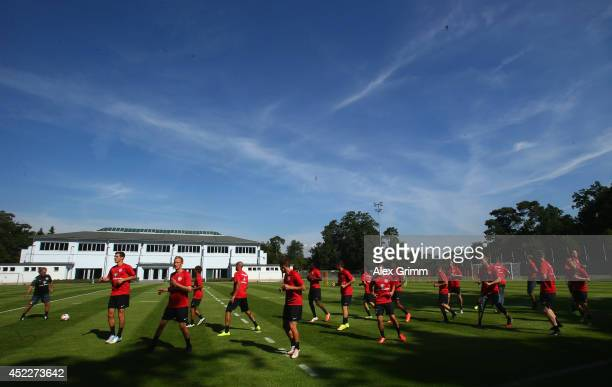 Players run during an Eintracht Frankfurt training session at Commerzbank Arena on July 17 2014 in Frankfurt am Main Germany