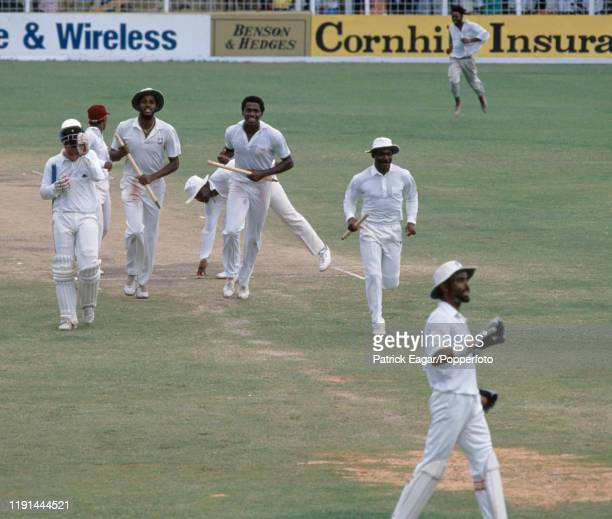 Players run from the field after West Indies bowler Ian Bishop takes the last England wicket of Nasser Hussain caught by West Indies wicketkeeper...