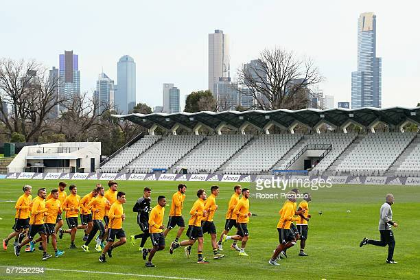 Players run laps during warm up after the Juventus FC welcome ceremony at Lakeside Stadium on July 19 2016 in Melbourne Australia