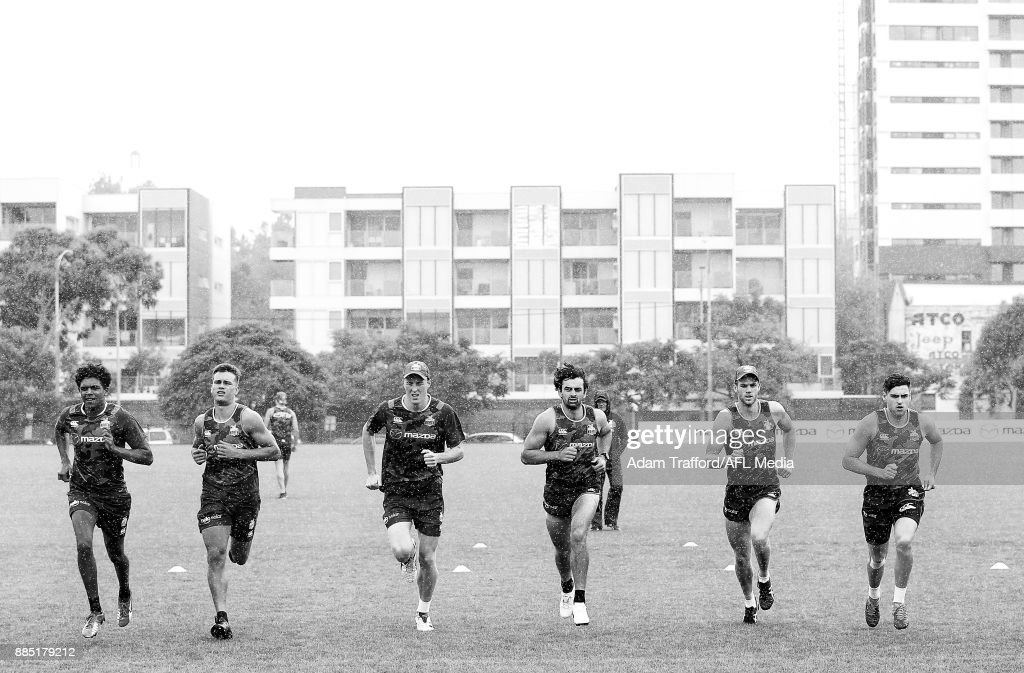 Players run the yo-yo test during the North Melbourne Kangaroos training session at Arden St on December 4, 2017 in Melbourne, Australia.