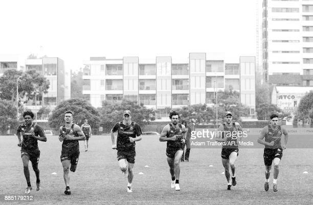 Players run the yoyo test during the North Melbourne Kangaroos training session at Arden St on December 4 2017 in Melbourne Australia