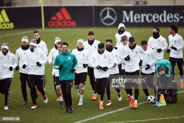 Players run with new fitness coach Nicklas Dietrich during a Germany training session ahead of their international friendly match against Spain at...
