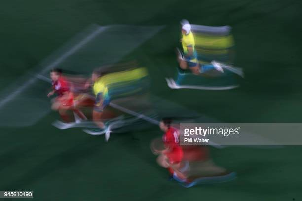 Players run with the ball in the Womens game between Australia and Wales during Rugby Sevens on day nine of the Gold Coast 2018 Commonwealth Games at...