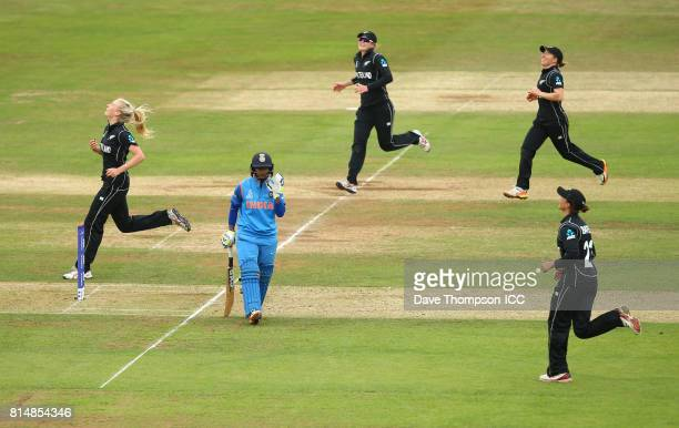 Players rush to congratulate Hannah Rowe of New Zealand after she took the wicket of Deepti Sharma of India during the ICC Women's World Cup match...