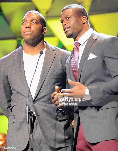 NFL players Russell Okung and Benjamin Watson speak onstage during the 16th Annual Super Bowl Gospel Celebration at ASU Gammage on January 30 2015 in...