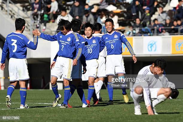 Players Sano Nihon Univ. Celebrate their 2-1 win after the 95th All Japan High School Soccer Tournament quarter final match between Sano Nihon Univ....