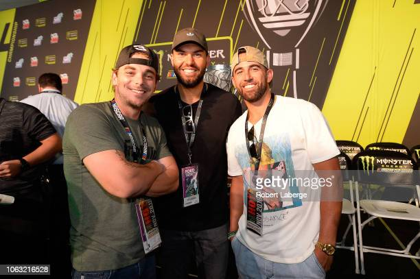 MLB players Scooter Gennett Deven Marrero and Eric Hosmer attend the driver's meeting prior to the Monster Energy NASCAR Cup Series Ford EcoBoost 400...