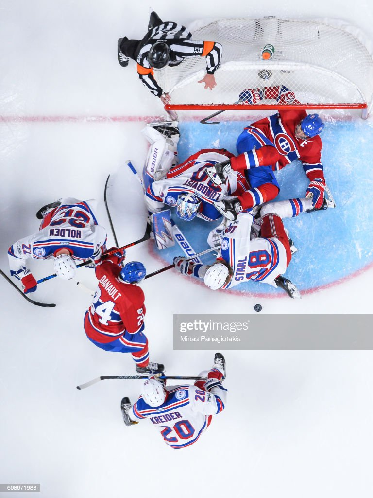 Players scramble in front of the net as Max Pacioretty #67 of the Montreal Canadiens falls over goaltender Henrik Lundqvist #30 of the New York Rangers in Game Two of the Eastern Conference First Round during the 2017 NHL Stanley Cup Playoffs at the Bell Centre on April 14, 2017 in Montreal, Quebec, Canada. The Montreal Canadiens defeated the New York Rangers 4-3 in overtime.