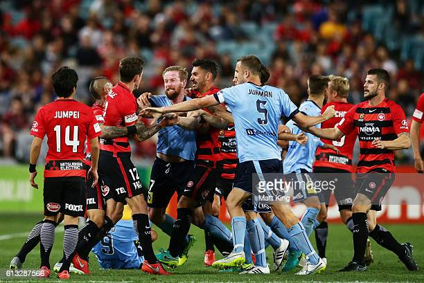 Players scuffle after a tackle on Bob of Sydney FC during the round one ALeague match between the Western Sydney Wanderers and Sydney FC at ANZ...