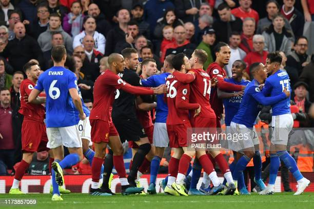 Players scuffle at the final whistle during the English Premier League football match between Liverpool and Leicester City at Anfield in Liverpool...