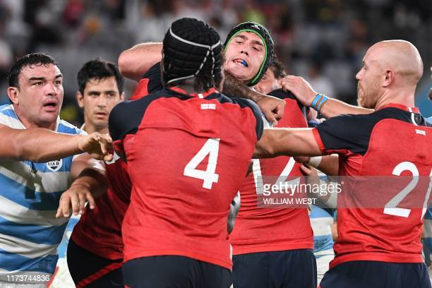 Players scuffle during the Japan 2019 Rugby World Cup Pool C match between England and Argentina at the Tokyo Stadium in Tokyo on October 5 2019