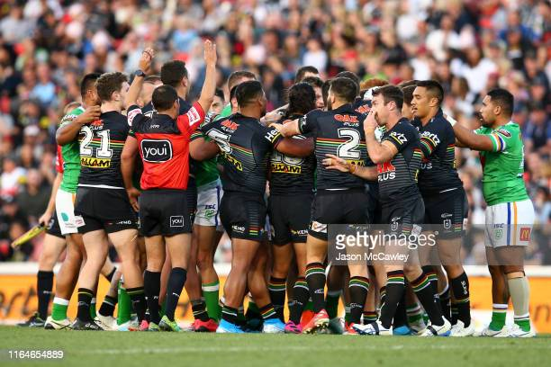 Players scuffle during the round 19 NRL match between the Panthers and Raiders at Panthers Stadium on July 28, 2019 in Penrith, Australia.