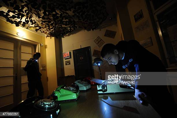 Players search for clues in a room while taking part in the virtual Escape Room game in Novi Sad on January 31 2014 Those fed up with computer gaming...