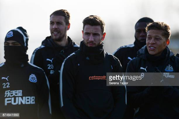 Players seen LR DeAndre Yedlin Florian Lejeune Paul Dummett Chancel Mbemba and Dwight Gayle look on during the Newcastle United Training session at...