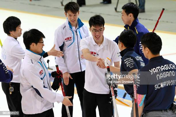 Players shake hands after SC Karuizawa beat Team IWAI on day three of the 2018 PacificAsia Curling Championships Trial at Advics Tokoro Curling Hall...