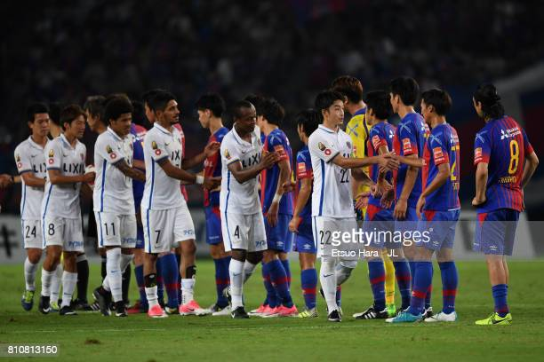 Players shake hands after the 2-2 draw in the J.League J1 match between FC Tokyo and Kashima Antlers at Ajinomoto Stadium on July 8, 2017 in Chofu,...
