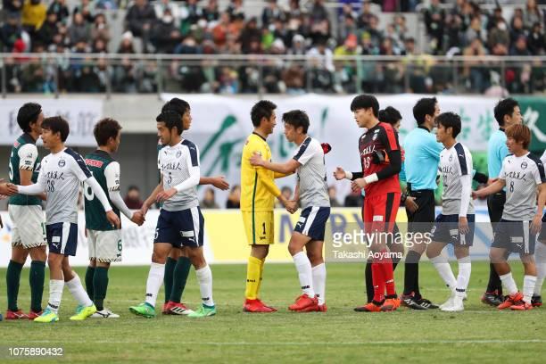 Players shake hands after the JLeague J3 match between SC Sagamihara and Kagoshima United at Gion Stadium on December 02 2018 in Sagamihara Kanagawa...