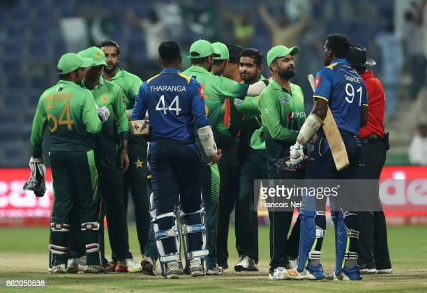 Players shake hands after the second One Day International match between Pakistan and Sri Lanka at Zayed Cricket Stadium on October 16 2017 in Abu...