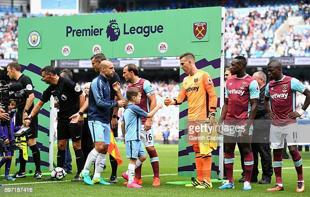 Players shake hands ahead of the Premier League match between Manchester City and West Ham at Etihad Stadium on August 28 2016 in Manchester England