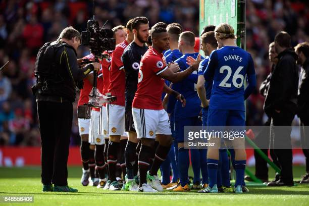Players shake hands before the Premier League match between Manchester United and Everton at Old Trafford on September 17 2017 in Manchester England