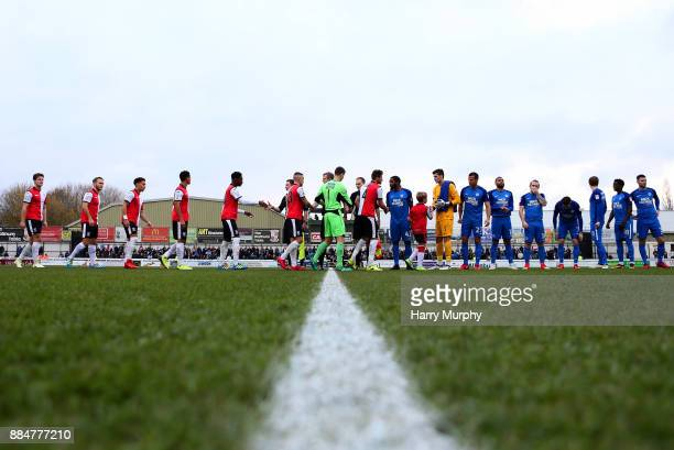 Players shake hands prior to the Emirates FA Cup Second Round match between Woking and Peterborough United at the Laithwaite Community Stadium on...