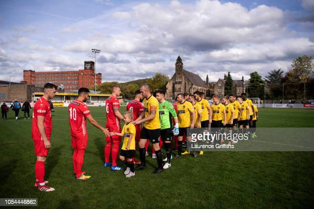 Players shake hands prior to the FA Preliminary Round match between Belper Town and Stamford on October 13, 2018 in Belper, England.