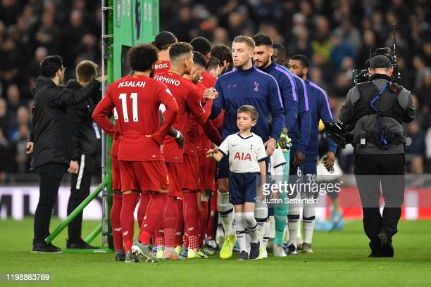 Players shake hands prior to the Premier League match between Tottenham Hotspur and Liverpool FC at Tottenham Hotspur Stadium on January 11 2020 in...