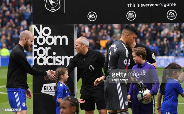 Players shake hands with officilas infront of the No Room for Racism baord before the Premier League match between Cardiff City and Chelsea FC at...