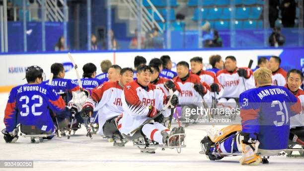 Players shale hands after the Ice Hockey Preliminary Round Group B match between Japan and South Korea on day one of the PyeongChang 2018 Paralympic...
