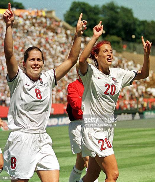 US players Shannon MacMillan and Kate Sobrero celebrate after defeating Brazil 20 in their Women's World Cup semifinal match 04 July 1999 at Stanford...