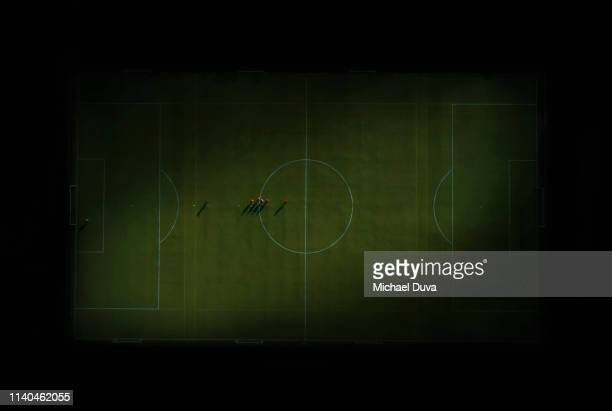 players shooting goals on soccer field, practicing  directly above - stadium stock pictures, royalty-free photos & images