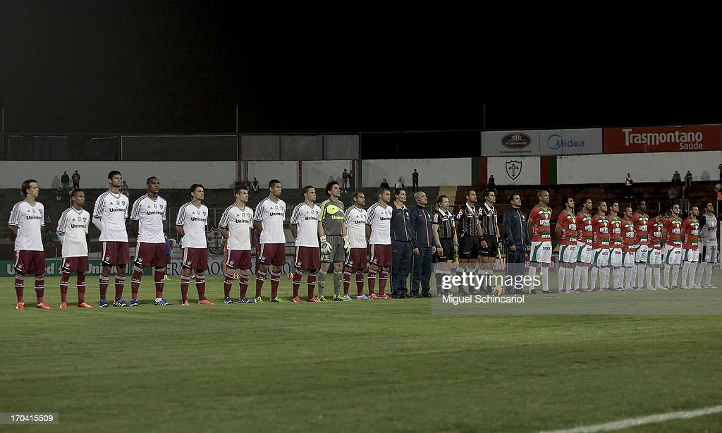 Players sing the national anthem before a match between Portuguesa and Fluminense as part of the Brazilian Serie A 2013 at Caninde stadium on June 12, 2013 in Sao Paulo, Brazil