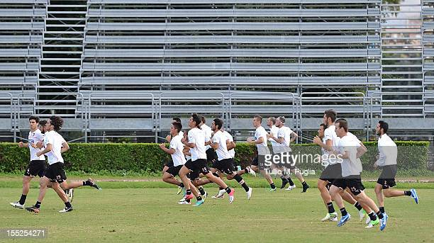 Players sprint during a Palermo training session at Tenente Carmelo Onorato Sports Center on November 2 2012 in Palermo Italy