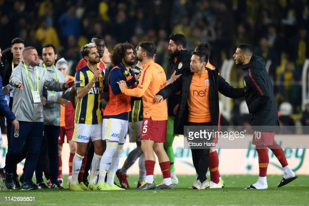 Players square off after the Turkish Super Lig match between Fenerbahce and Galatasaray at Şukru Saracoglu Stadium on April 14 2019 in Istanbul Turkey