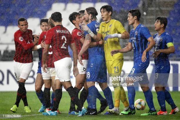 Players square off during the AFC Champions League round of 16 second leg match between Ulsan Hyundai and Urawa Red Diamonds at Ulsan Munsu Stadium...