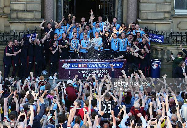 Players staff and fans celebrate as captain Tom Heaton lifts the trophy as Sky Bet Champions Burnley are presented with the Championship trophy at...