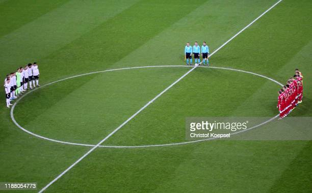 Players, staff and spectators participate in a minute of silence in remembrance of late goalkeeper Robert Enke, who died on 10 November 2009 prior to...