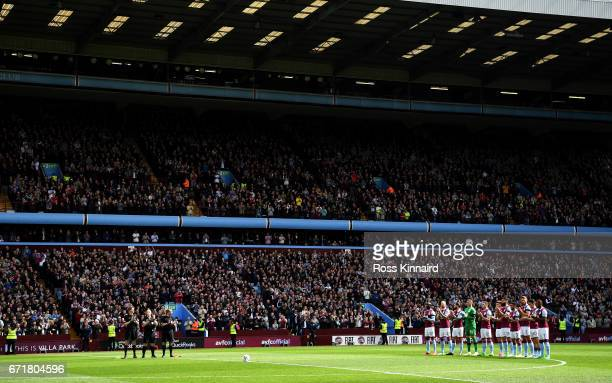 Players stand at the minute of applaud for Ugo Ehiogu prior to the Sky Bet Championship match between Aston Villa and Birmingham City at Villa Park...