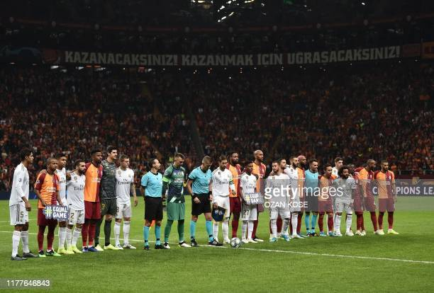 Players stand before the UEFA Champions League group A football match between Galatasaray and Real Madrid on October 22 2019 at the Ali Sami Yen Spor...