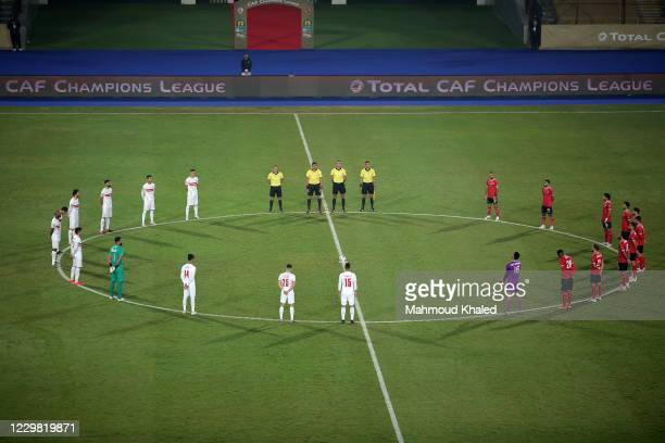 Players stand for a minute of silence for the late Diego Maradona before CAF Champions League Final between Zamalek and Al Ahly at Cairo stadium on...