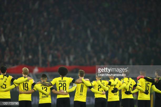 Players stand for a minutes silence in memory of Hans Tilkowski during the Bundesliga match between Borussia Dortmund and 1. FC Koeln at Signal Iduna...