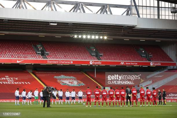 Players stand for a moment silence following the death of Britain's Prince Philip, Duke of Edinburgh yesterday, ahead of the English Premier League...