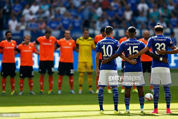 Players stand for one minutes silence prior to the Bundesliga match between FC Schalke 04 and SV Darmstadt 98 held at VeltinsArena on August 22 2015...