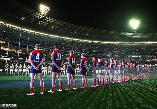 Players stand for the Last Post for Anzac Day during the round five AFL match between the Melbourne Demons and the Richmond Tigers at Melbourne...