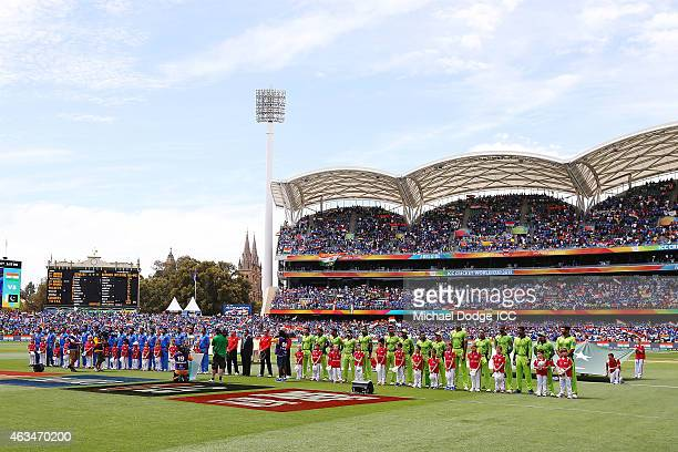 Players stand for the national anthem during the 2015 ICC Cricket World Cup match between India and Pakistan at Adelaide Oval on February 15 2015 in...