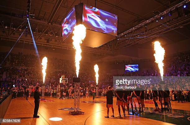 Players stand for the national anthem during the round eight NBL match between Melbourne United and the Sydney Kings at Hisense Arena on November 26...