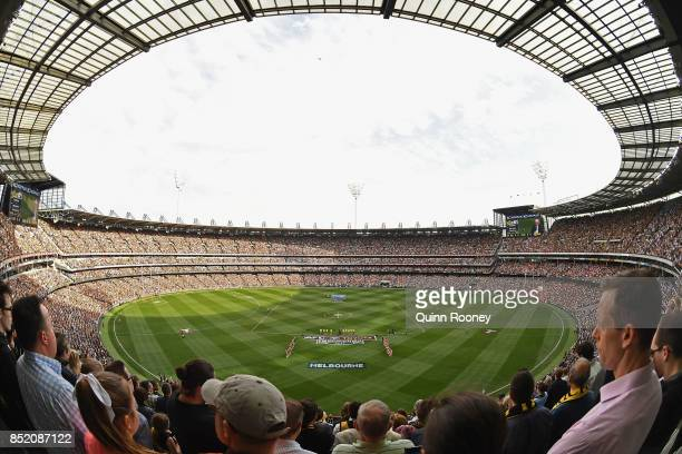 Players stand for the national anthem during the Second AFL Preliminary Final match between the Richmond Tigers and the Greater Western Sydney Giants...