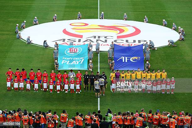 Players stand for their national anthems during the 2015 Asian Cup final match between Korea Republic and the Australian Socceroos at ANZ Stadium on...